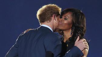 Prince Harry hugs First Lady Michelle Obama during opening ceremonies for the Invictus Games at Disney's ESPN Wide World of Sports in Orlando, Fla., on Sunday, May 8, 2016. (Stephen M. Dowell/Orlando Sentinel/TNS via Getty Images)