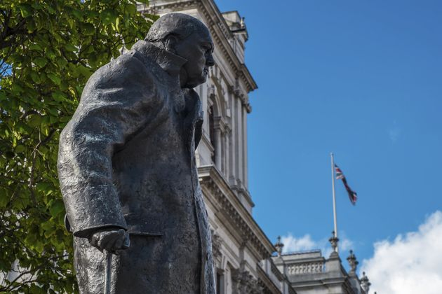 A statue of Sir Winston Churchill looks out over Parliament