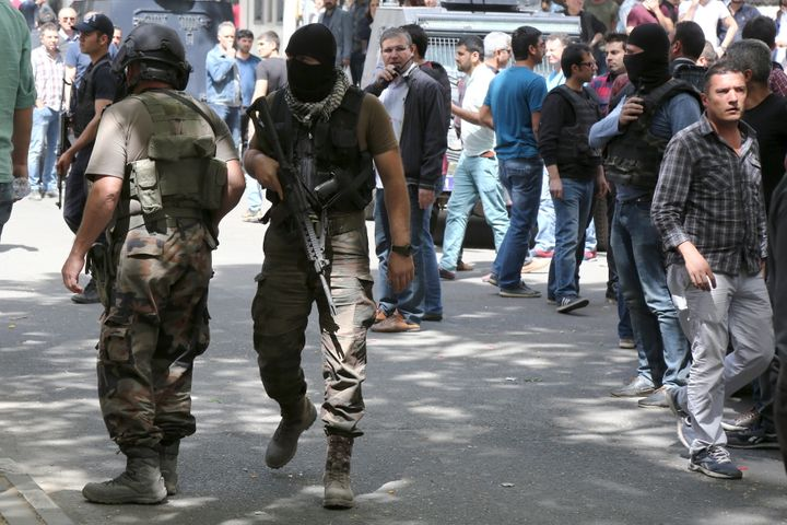 Members of the Turkish police special forces secure a street. Nine members of the separatist Kurdistan Workers Party and one