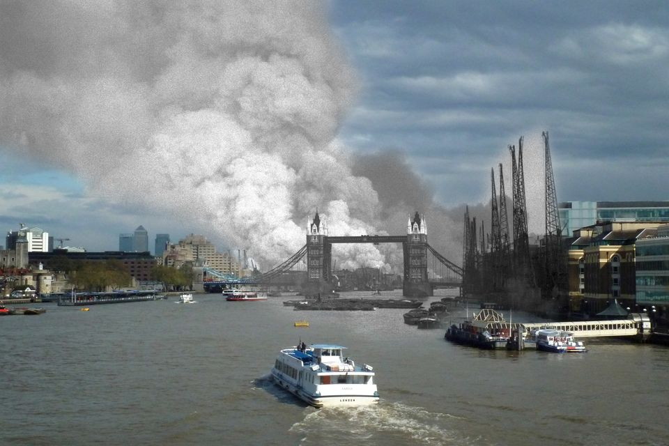 A view east down the Thames towards smoke rising from fires in Surrey docks, following the first German air raid of the Londo
