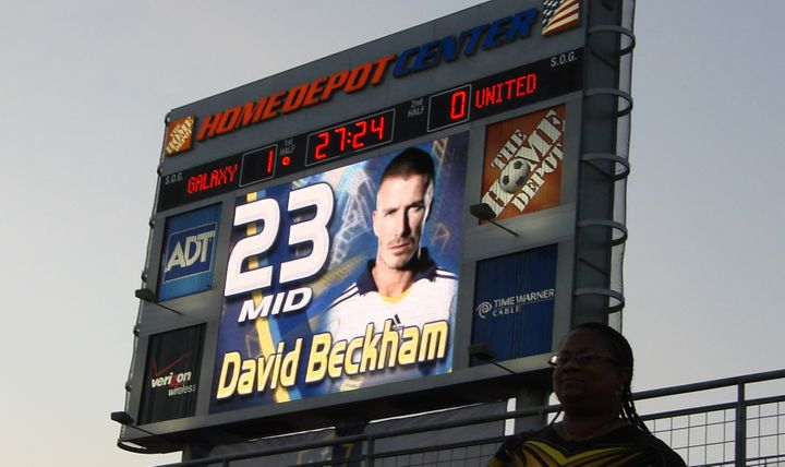 "<br><br><a href=""https://www.flickr.com/photos/yotut/1144131447/"" target=""_blank"">Fan watches on as Beckham appears on the sc"