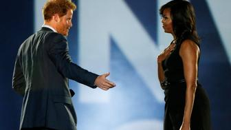 Britain's Prince Harry (L) and U.S. First Lady Michelle Obama take part in the opening ceremonies of the Invictus Games in Orlando, Florida, U.S., May 8, 2016.  REUTERS/Carlo Allegri     TPX IMAGES OF THE DAY