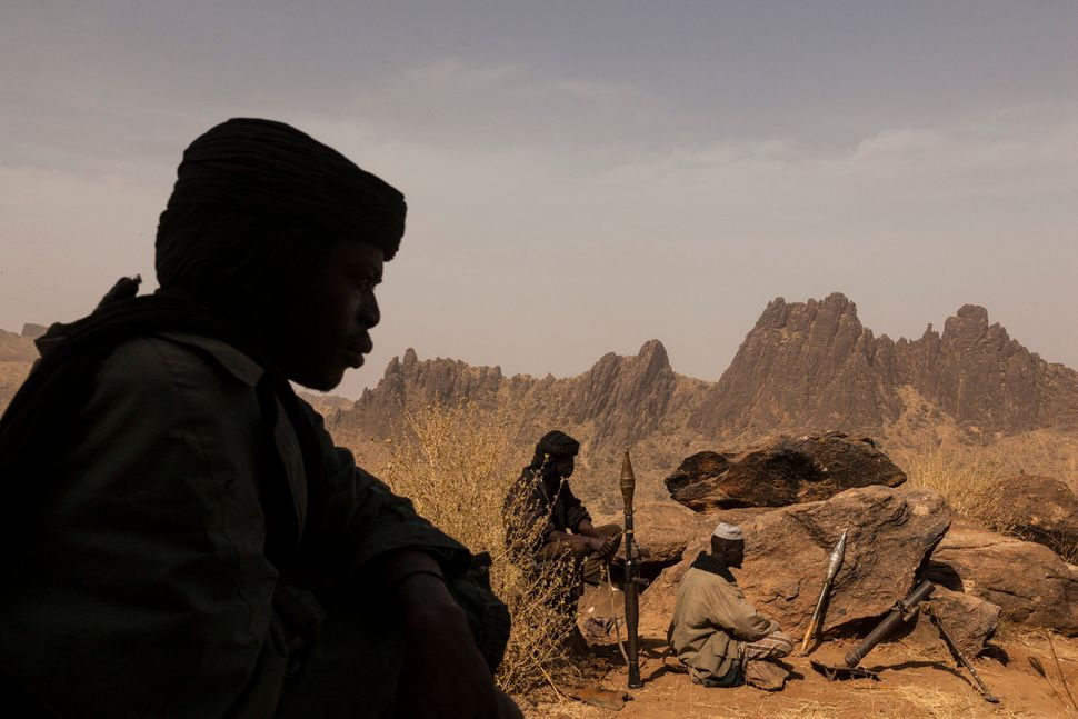 Members of the rebel group, the Sudan Liberation Army defends a mountain from the Sudanese government forces in Central Darfu
