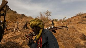 The Sudan Liberation Army led by Abdul Wahid (SLA-AW) climb towards the front lines in the last rebel-held territory in Central Darfur, Sudan, March 4, 2015.