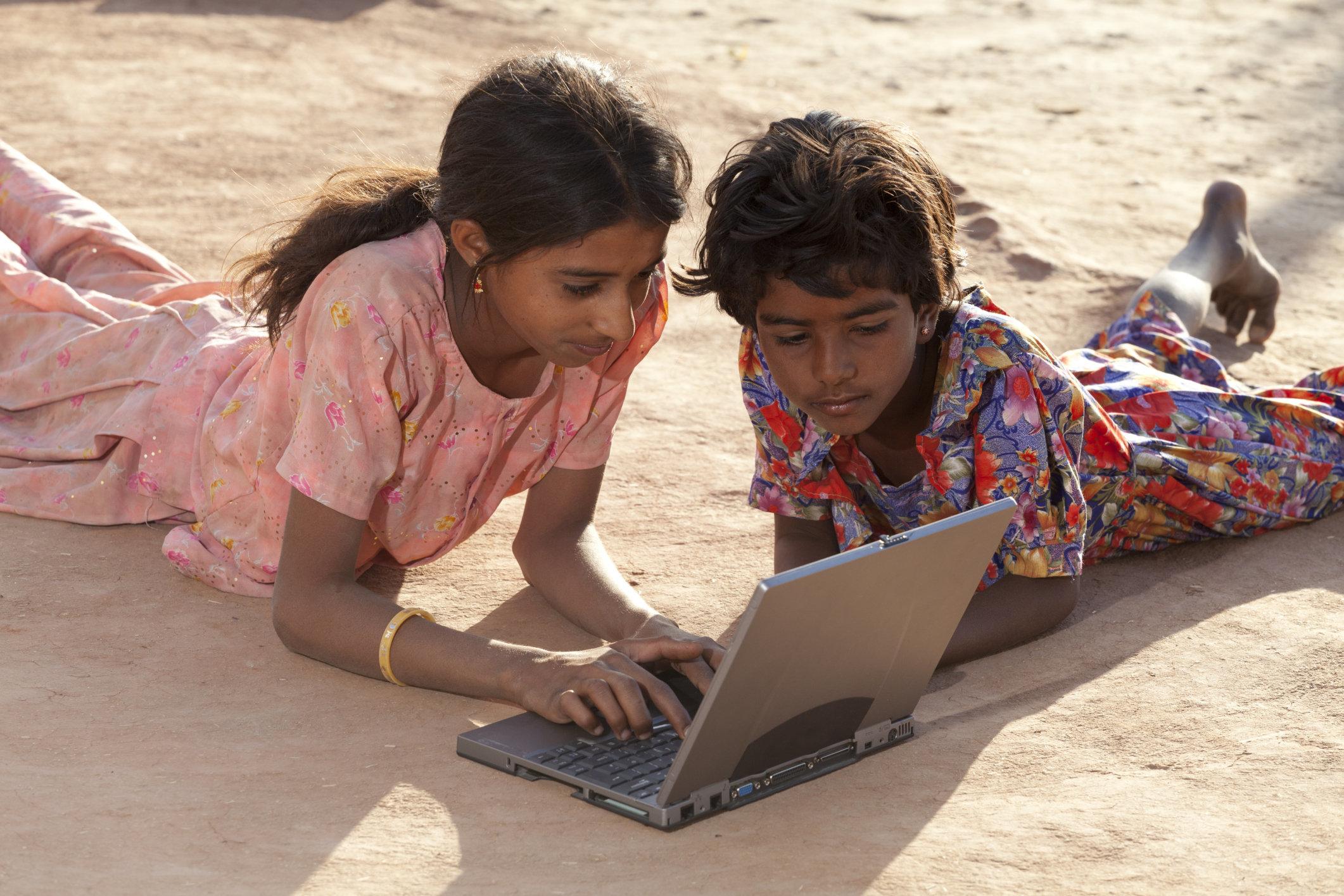 India, Rajasthan, Jodhpur, two village girls using laptop