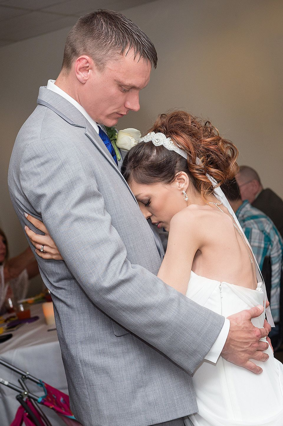 Brandon Thomas and Destini Schafer have their first dance at their reception held in a conference room at Memorial Medical Ce