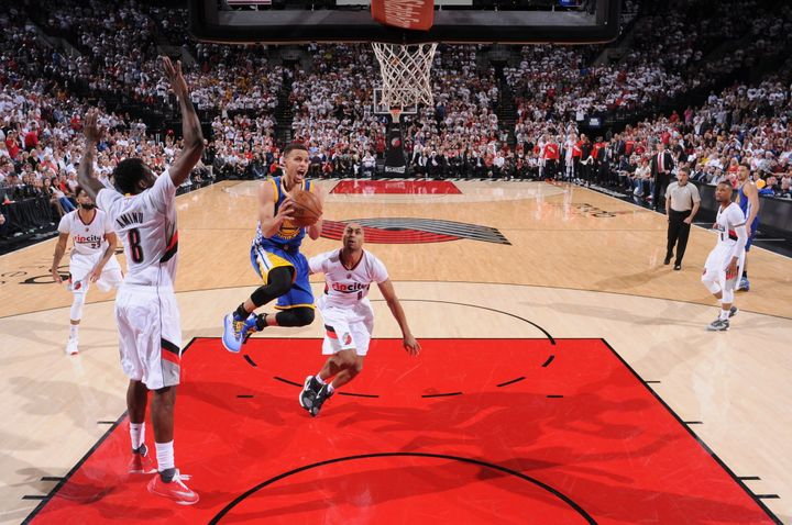Stephen Currydrives to the rimagainst the Portland Trail Blazers in Game Four of the Western Conference Semifinal