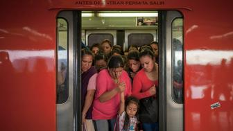 A woman holds a young girl's hand as they exit a train at the Pantitlan Metro station in Mexico City, Mexico, on Tuesday, Sept. 8, 2015. Mexico City has the second-largest metro system in North America after New York, with 12 lines and 195 stations serving a population of 20.1 million people in the metropolitan area. Photographer: Christian Rodriguez/Bloomberg via Getty Images