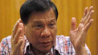 Rodrigo Duterte, seven-term mayor of Davao city, who has built a reputation for fighting crime in the insurgency-plagued southern Philippines, gestures during an interview with Reuters in Manila, Philippines, in this file picture taken December 10, 2015.    REUTERS/Czar Dancel/File Photo         SEARCH ÒDUTERTE PRESIDENCYÓ FOR ALL IMAGES