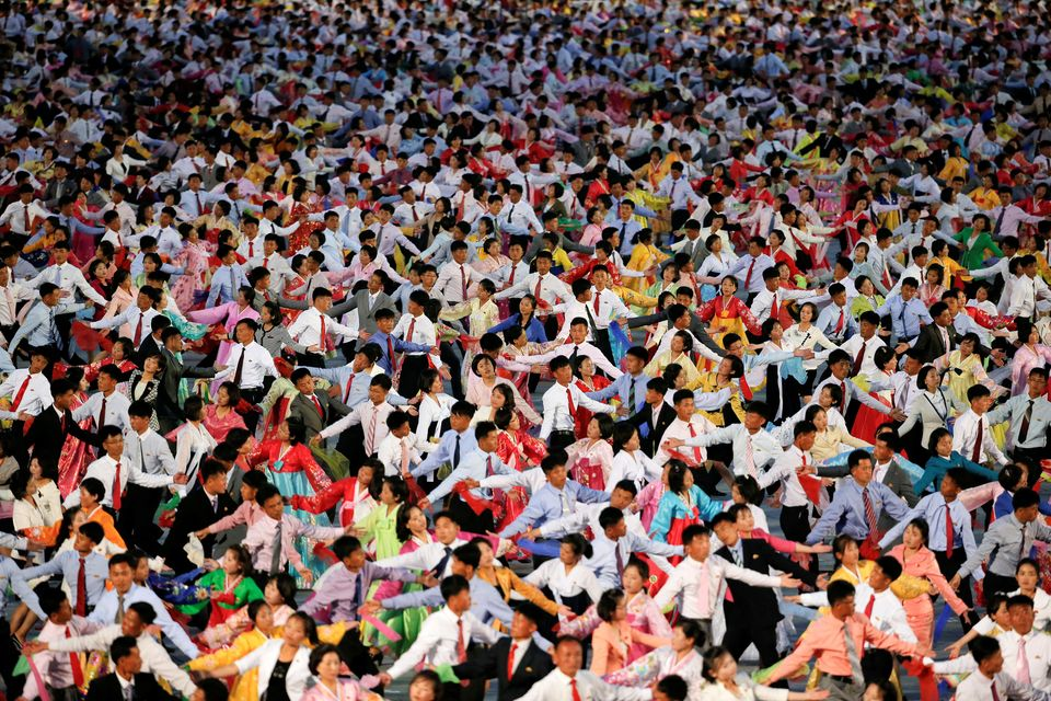 Thousands of people in North Korea marched through the streets on Tuesday asleader Kim Jong Un...