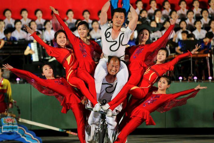 Acrobats perform in the ceremony.