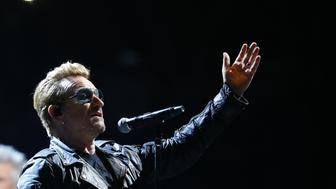 Irish band U2 singer Bono performs on stage at the Bercy Accordhotels Arena in Paris on December 6, 2015.  / AFP / THOMAS SAMSON        (Photo credit should read THOMAS SAMSON/AFP/Getty Images)