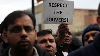 NEW YORK, NY - FEBRUARY 01:  Uber drivers protest  the company's recent fare cuts and go on strike in front of the car service's New York offices on February 1, 2016 in New York City. The drivers say Uber continues to cut into their earnings without cutting into its own take from each ride. In claiming fare reduction would mean more work for drivers, the San Francisco based company cut its prices by 15 percent last week.  (Photo by Spencer Platt/Getty Images)