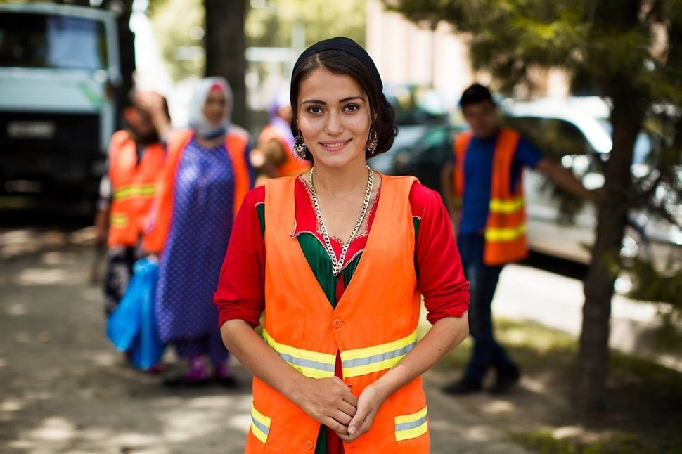 I met her on the streets of Dushanbe, Tajikistan. Her job was to plant flowers on the streets of her city. Even a minimum sal