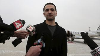 Former U.S. Marine Amir Hekmati, recently released from an Iranian prison, arrives at an airport in Flint, Michigan January 21, 2016.      REUTERS/Rebecca Cook