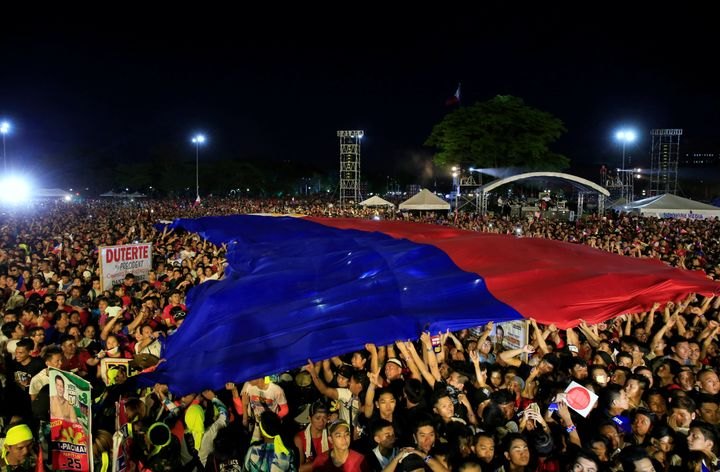 Supporters of Philippines presidential candidate and Davao city mayor Rodrigo 'Digong' Duterte display a huge Philippines fla