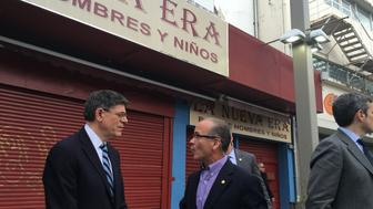 Treasury Secretary Jack Lew talks to the president of Puerto Rico's Chamber of Commerce, José Vazquez Barquet, about the debt crisis' toll on businesses.