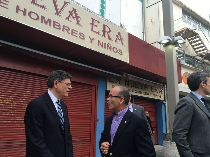 Treasury Secretary Jack Lew talks to the president of Puerto Rico's Chamber of Commerce, José Vazquez Barquet, ab