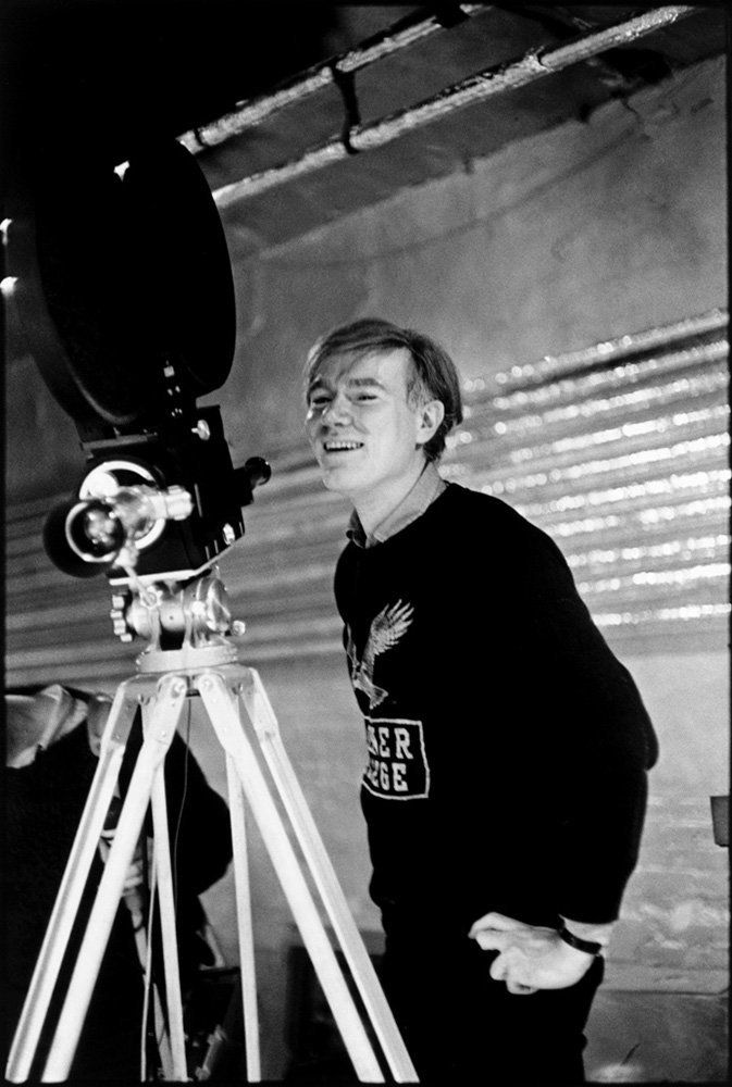 Andy Warhol at the Silver Factory with his first sophisticated anchored camera in 1964.