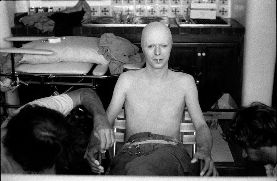 """David Bowie in the process of being made up for his acting role in the cult film """"<strong>The Man Who Fell to Earth</strong>,"""