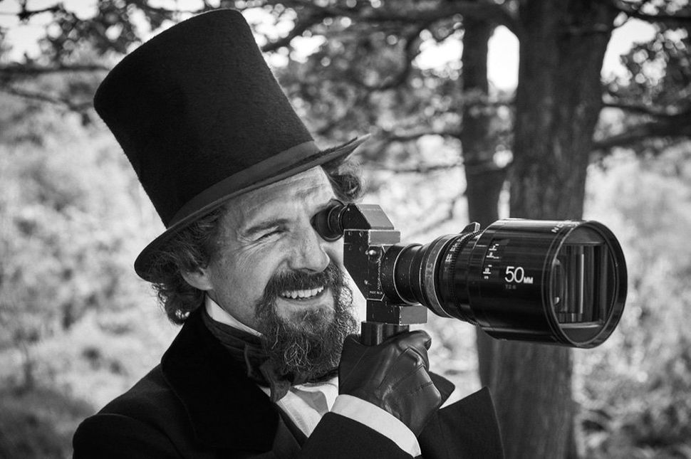 "Director and leading man Ralph Fiennes looking through the viewfinder on the set of ""<strong>The Invisible Woman</strong>"" in"