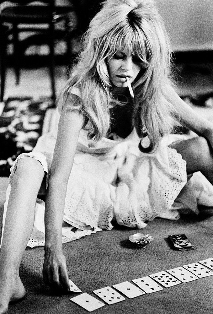 "French actress Brigitte Bardot plays cards on set of the comedy-adventure film ""<strong>Viva Maria</strong>,"" 1965."