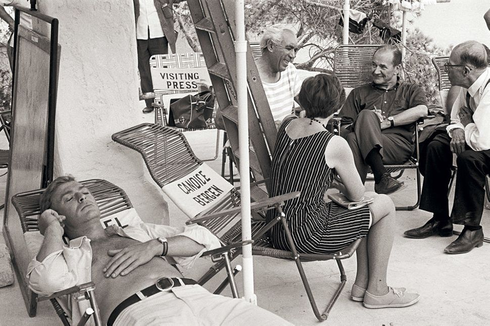 """British actor Michael Caine takes a rest with Anthony Quinn during the filming of Guy Green's 1968 film """"<strong>The Magus</s"""