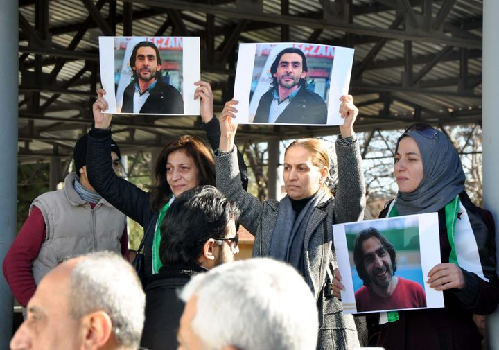 Women hold pictures of anti-ISIS filmmaker Naji Jerf during his funeral in Gaziantep on Dec. 28, 2015. Extremists from the mi
