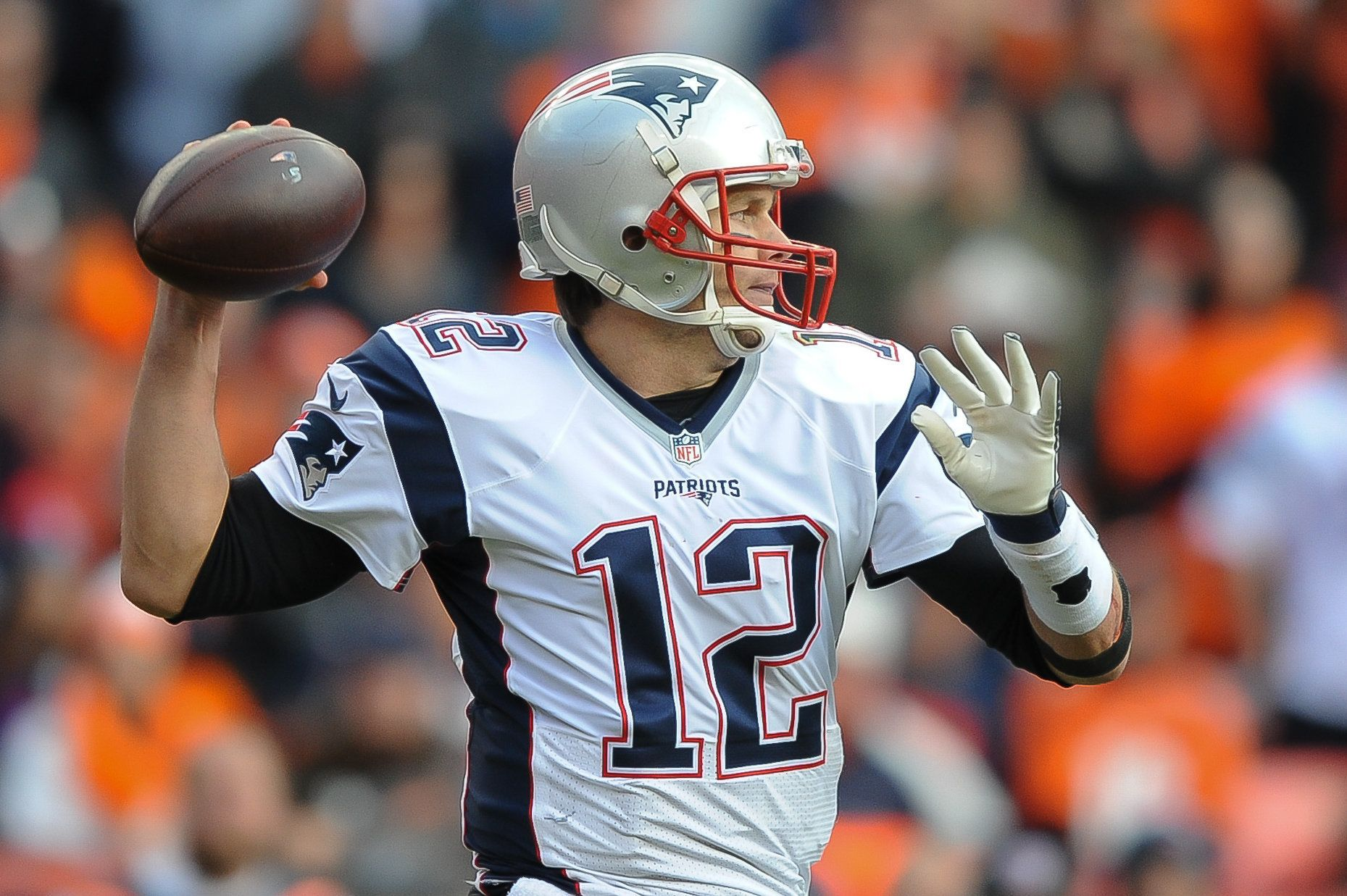 DENVER, CO - JANUARY 24: Tom Brady #12 of the New England Patriots passes against the Denver Broncos   in the AFC Championship game at Sports Authority Field at Mile High on January 24, 2016 in Denver, Colorado.  (Photo by Dustin Bradford/Getty Images)