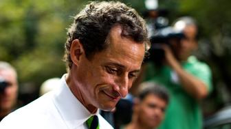 New York City Democratic mayoral candidate Anthony Weiner leaves a polling center after casting his vote during the primary election in New York September 10, 2013. REUTERS/Eduardo Munoz (UNITED STATES - Tags: POLITICS ELECTIONS HEADSHOT)