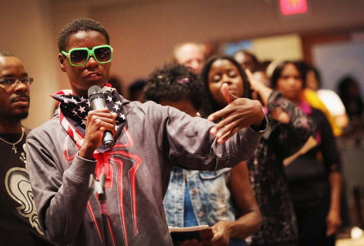 Williams became well known in and around Ferguson during the protests for wearing neon-green sunglasses and an American