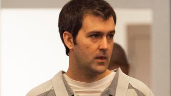 Former South Carolina police officer Michael Slager walks to the defense table during his bond hearing in Charleston, South Carolina September 10, 2015. Slager is charged with killing unarmed black man Walter Scott, 50, who ran from a traffic stop. The shooting, caught on video by a bystander using his cellphone, showed Slager firing his gun eight times at Scott's back as the motorist fled from the officer. REUTERS/Randall Hill
