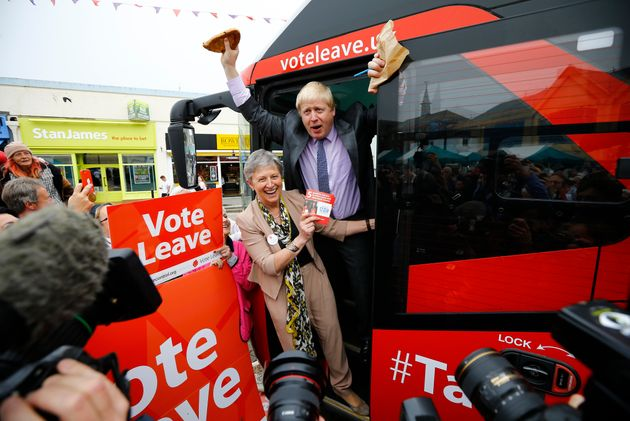 Boris Johnson holds up a Cornish pasty during the launch of the Vote Leave bus campaign, in favour of...