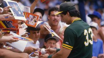 BRONX, NY - UNDATED: Jose Canseco #33 of the Oakland Athletics signs autographs at Yankee Stadium during the 1980s in Bronx, New York. (Photo by Focus On Sport/Getty Images)