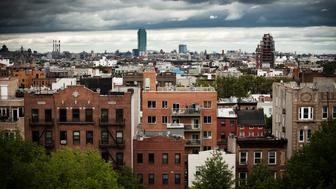 Apartment buildings as far as eye can see from rooftop in Williamsburg, Brooklyn, New York City.