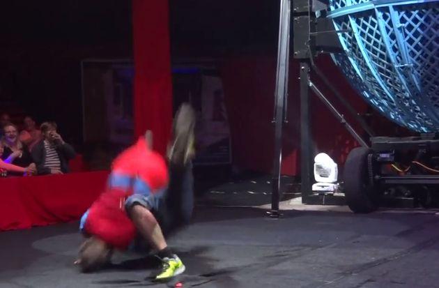 Coles lands on top of Garnham after performing a flip trick, and knocks him