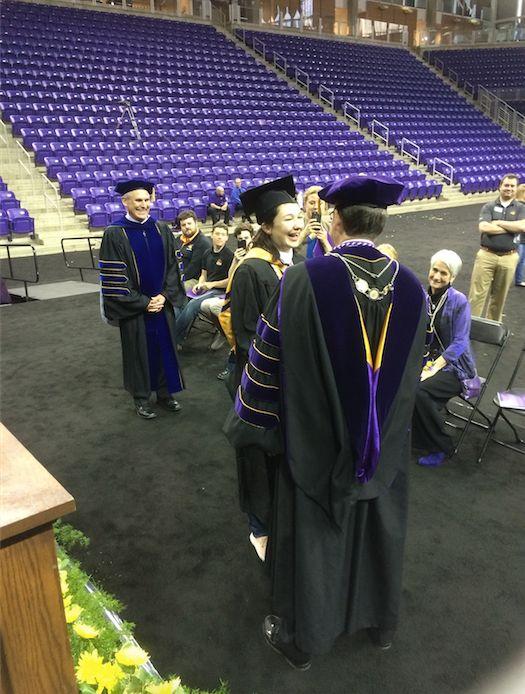 Johnston receives her diploma.