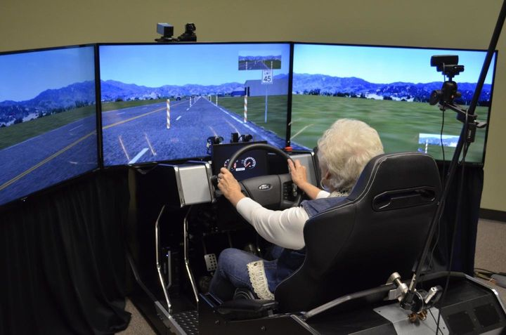 One of the 59 volunteers in a distracted driving study by the University of Houston and Texas A&M Transportation Institute sits in a high-fidelity driving simulator.