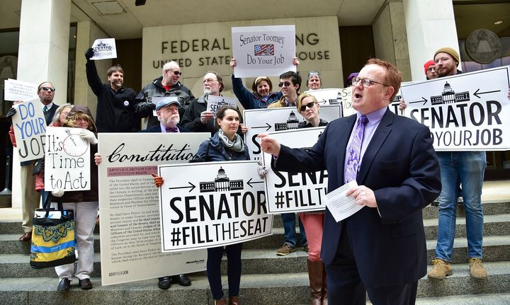 """Protesters outside of Sen. Pat Toomey's (R-Pa.) Harrisburg office in March urged him to """"do your job"""" and vote onPresid"""