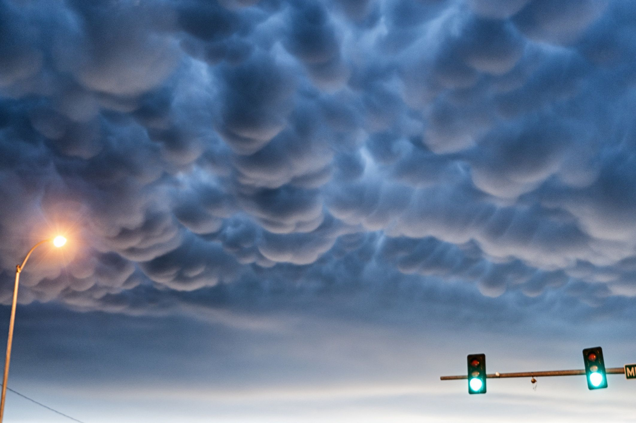 Mammatus clouds and traffic signals and street light, South Dakota, USA.