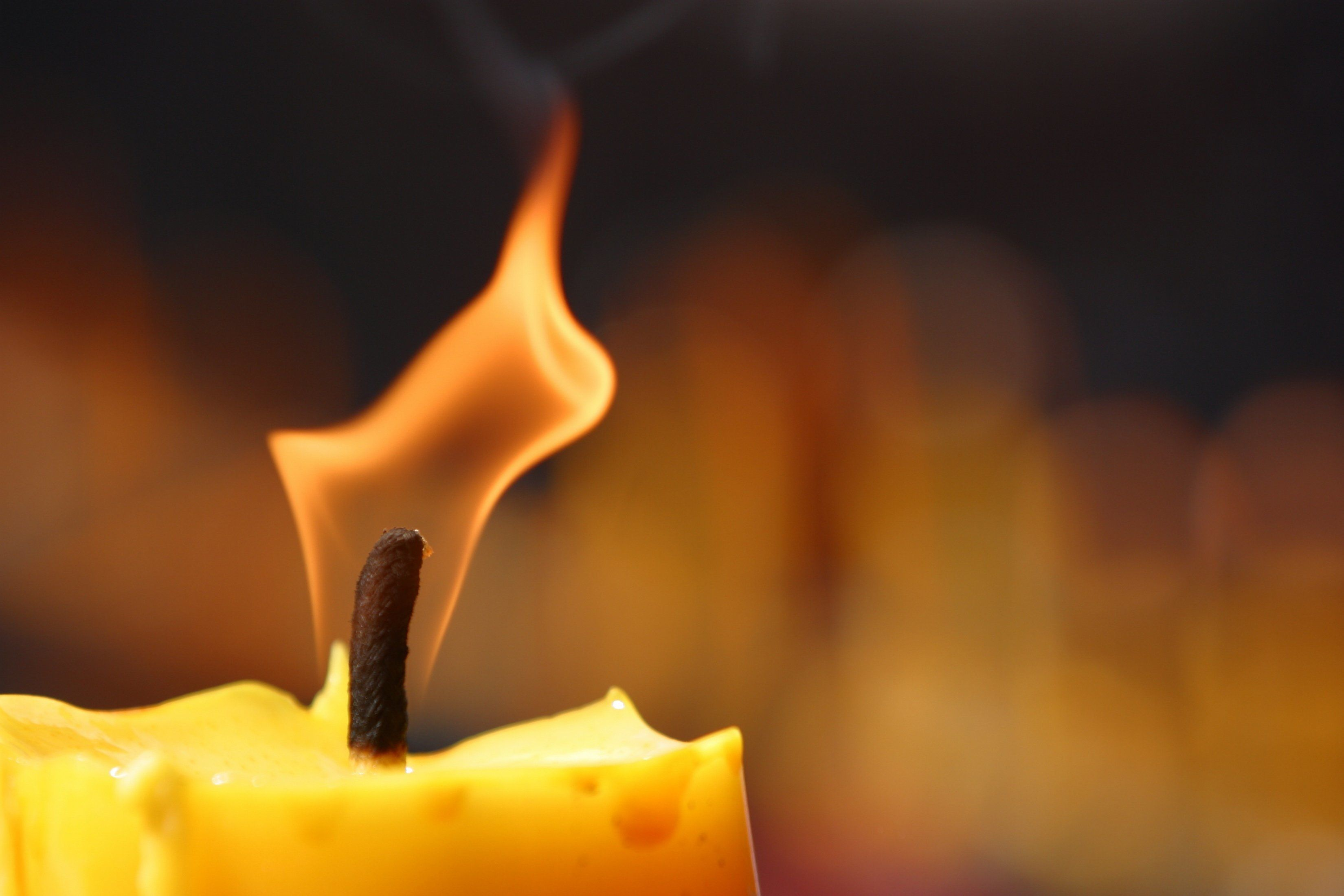 Burning symbolic candle