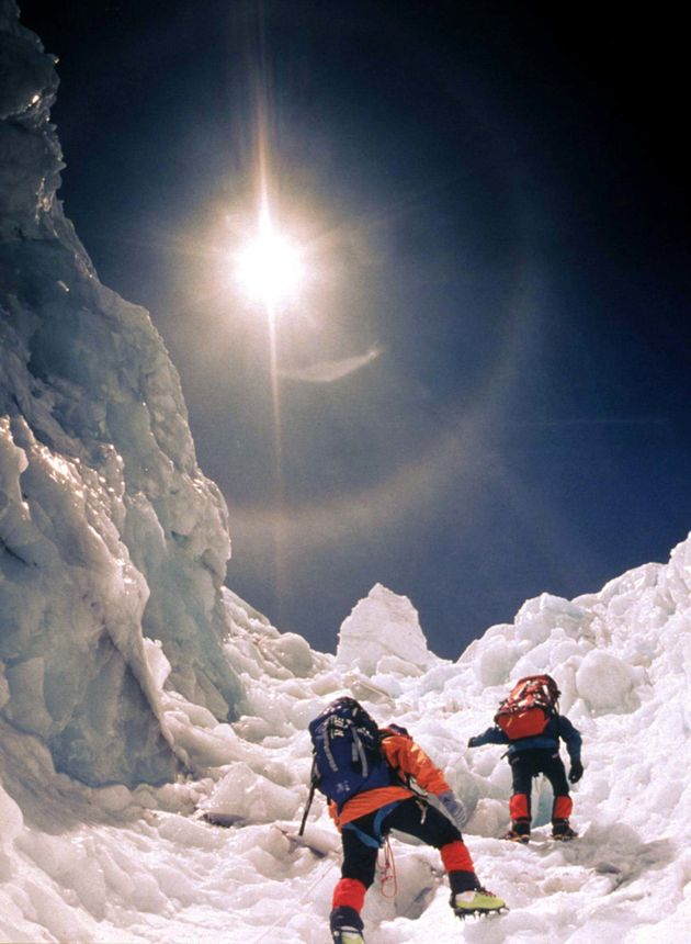 Two climbers scale the treacherous Khumbu Icefall in May