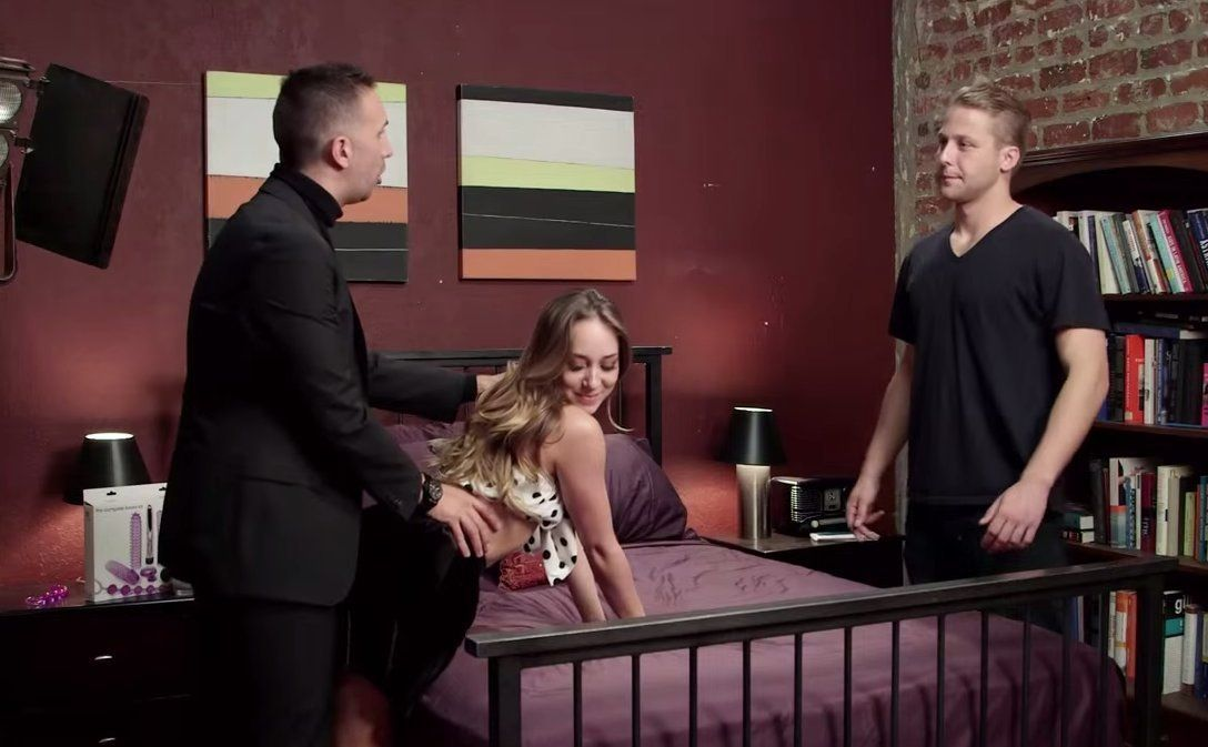 "Keiran Lee and Remy LaCroix demonstrate the finer points of porn to a contestant on ""The Sex Factor."""