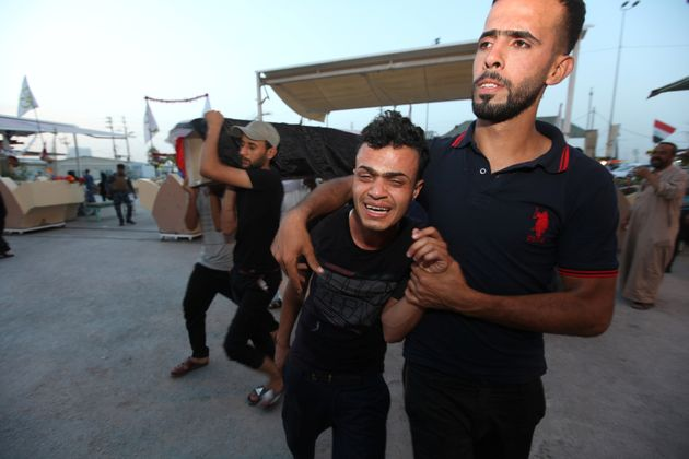 Islamic State suicide bombers killed two policeman in Abu Ghraib on Thursday, a day after a triple bombing...