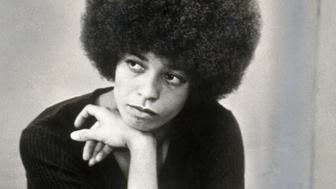American revolutionary and educator Angela Davis sits with her head on her hand, shortly after she was fired from her post as philosophy professor at UCLA due to her membership of the Communist Party of America, 27th November 1969. Davis followed up her brilliant early academic career by joining the Black Panthers and being listed on the FBI Most Wanted list. She was acquitted of all charges and continues to be a writer, educator, and activist for race, class, and gender equality. (Photo by Hulton Archive/Getty Images)