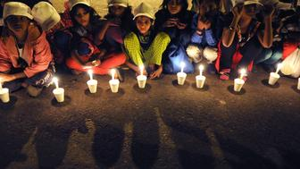 NEW DELHI, INDIA  NOVEMBER 22: Children take part in a candle light vigil to end child slavery oragnized by NGO Bachpan Bachao Andolan at Jantar Mantar on November 22, 2014 in New Delhi, India.  Terming slavery and child trafficking the biggest scandal of our times, Indian Nobel laureate Kailash Satyarthi launched a new campaign to end the menace posed by the trafficking mafia. (Photo by Subrata Biswas/Hindustan Times via Getty Images)