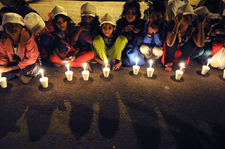 NEW DELHI, INDIA NOVEMBER 22: Children take part in a candle light vigil to end child slavery oragnized by NGO Bachpan Bachao