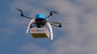 An Australia Post drone is pictured during trials of delivering packages from the air in this handout picture taken in Melbourne, Australia, April 15, 2016. Australia Post has successfully field-trialled the use of drones to deliver small packages, clearing the way for test deliveries to customer homes later this year. Picture taken April 15, 2016.   REUTERS/Australia Post/Handout via Reuters   ATTENTION EDITORS - THIS PICTURE WAS PROVIDED BY A THIRD PARTY. REUTERS IS UNABLE TO INDEPENDENTLY VERIFY THE AUTHENTICITY, CONTENT, LOCATION OR DATE OF THIS IMAGE. EDITORIAL USE ONLY. NOT FOR SALE FOR MARKETING OR ADVERTISING CAMPAIGNS. NO RESALES. NO ARCHIVE. THIS PICTURE IS DISTRIBUTED EXACTLY AS RECEIVED BY REUTERS, AS A SERVICE TO CLIENTS.  TPX IMAGES OF THE DAY