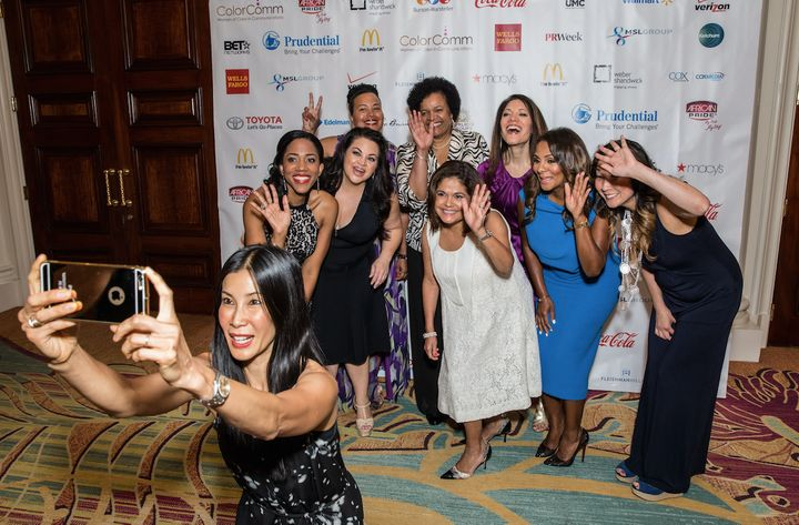 Lisa Ling takes a selfie with guests at the 2015 ColorComm conference.