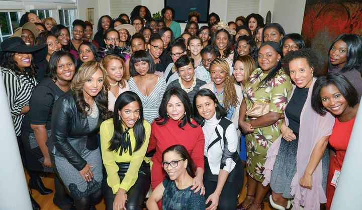 Members of ColorComm pose together for a picture at a network gathering.